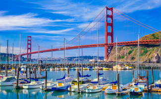 View of the Golden Gate Bridge and sailboats in San Francisco during the day